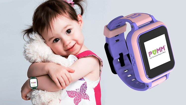 Young child wearing the POMM™ wearable tech device
